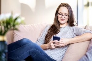 Smiling Young Woman Texting Messaging